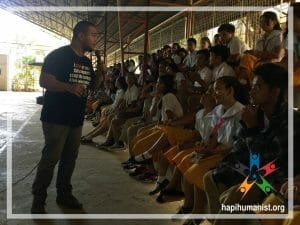 HAPI Executive Director AJ Ballares an conducting HIV / AIDS lecture in front of students